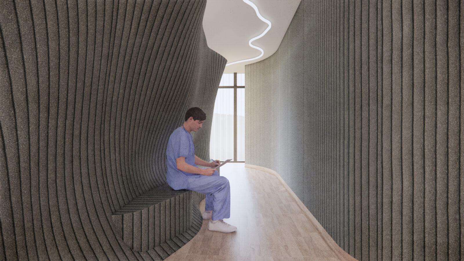 Corridor on level two of the building which features curved walls wrapped in fabric